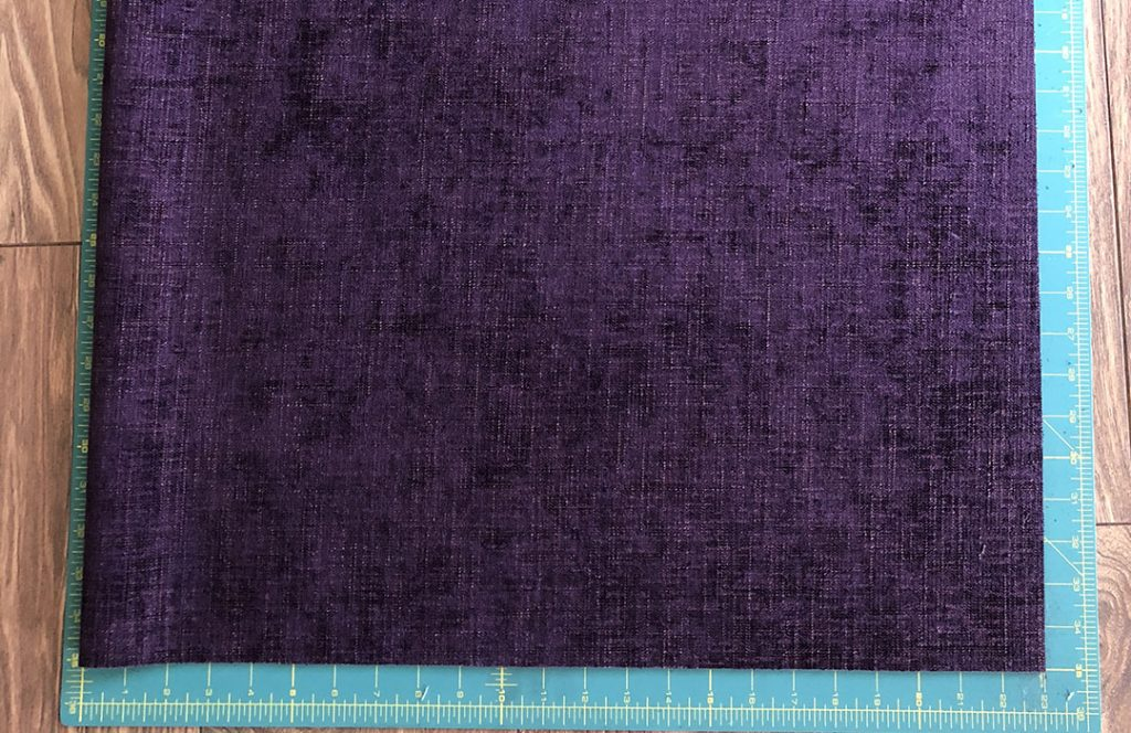 Cut fabric on cutting mat