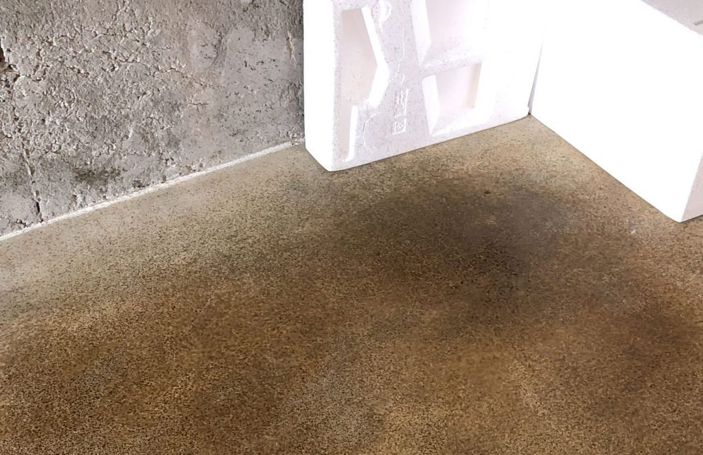 Test patch of concrete stain